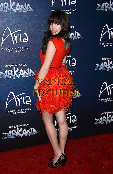 Claire Sinclair.Red Carpet Premiere of Zarkana by Cirque Du Soleil at Aria Resort and Casino, Las Vegas, Nevada, USA, .9th November 2012..full length red dress sheer feathers back over shoulder rear behind  .CAP/ADM/MJT.© MJT/AdMedia/Capital Pictures.