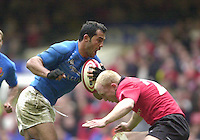 27/03/2004  -  RBS Six Nations Championship 2004 Wales v Italy.Italy's Christian Stoica runs into the tackle from Tom Shanklin.   [Mandatory Credit, Peter Spurier/ Intersport Images].