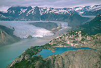 Aerial view of White Thunder Ridge with a blue pond and Riggs Glacier in background, Glacier Bay National Park, Alaska, AGPix_0658.
