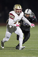 Cedar Ridge's Sammy Tran sets his sight on Rouse's Brandon Wells Friday at Dragon Stadium.  (LOURDES M SHOAF for Round Rock Leader.)