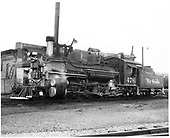 D&amp;RGW #476 K-28 in Durango with roundhouse in background.<br /> D&amp;RGW  Durango, CO  Taken by Payne, Andy M. - 9/23/1970