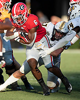 ATHENS, GA - SEPTEMBER 7: Kenny McIntosh #6 has two hands on the ball as he tries to advance the pile during a game between Murray State Racers and University of Georgia Bulldogs at Sanford Stadium on September 7, 2019 in Athens, Georgia.