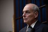 White House Chief of Staff, John Kelly, listens as United States President Donald J. Trump speaks with Republican members of congress in the Roosevelt Room of the White House on September 5, 2018 in Washington, DC. Credit: Alex Edelman / Pool via CNP