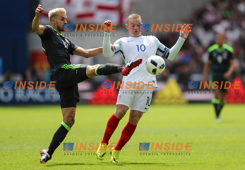 Aaron Ramsey of Wales and Wayne Rooney of England <br /> Lens 16-06-2016 Stade Bollaert-Delelis Footballl Euro2016 England - Wales / Inghilterra - Galles Group Stage Group B. Foto Daniel Chesterton / PHC / Panoramic / Insidefoto