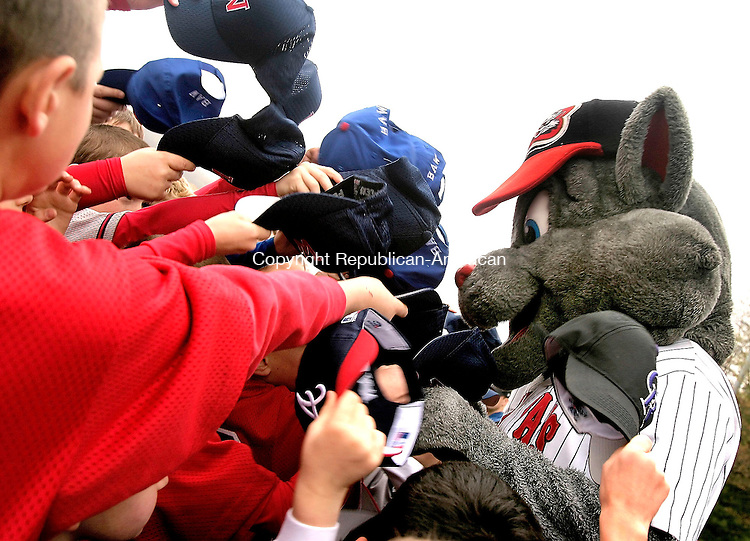 WOLCOTT, CT- 30 APRIL 2005-043005JS02--Rocky, the New Britain Rock Cats mascott, signs hats during opening ceremonies for the Baseball Association of Wolcott 2005 seaons Saturday prior to the parade from Frisbee School to the BAW baseball complex in Wolcott.  --- Jim Shannon Photo--Baseball Association of Wolcott; Rocky, New Britain Rock Cats are CQ