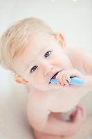 Blonde Toddler Brushing Teeth