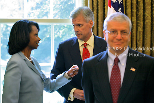 Washington, D.C. - July 16, 2007 -- United States Secretary of State Condoleezza Rice speaks with White House spokesman Tony Snow in the Oval Office of the White House while United States President George W. Bush meets with President Lech Kaczynski of Poland on Monday, July 16, 2007.  .Credit: Ken Cedeno - Pool via CNP