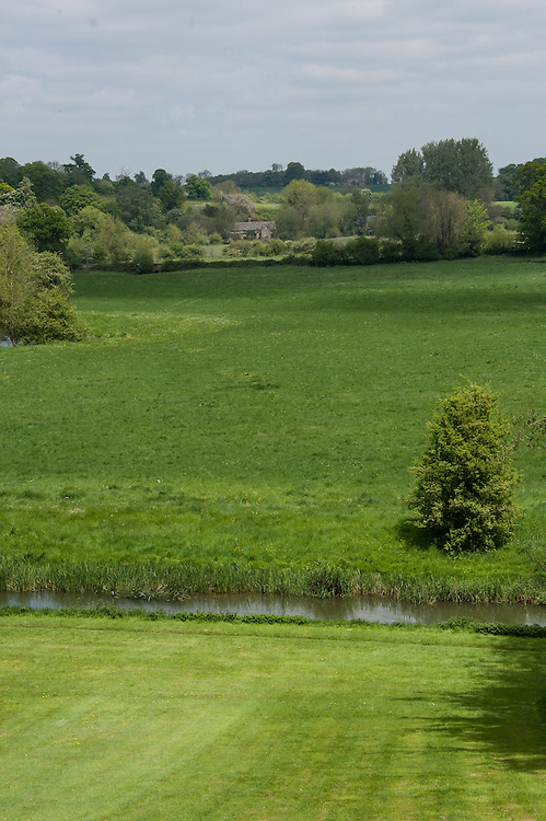 View from the Bowling Green over the River Cherwell. The Eyecatcher folly is on top of the hill in the distance.