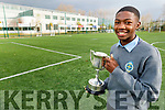 Togor Silong, CBS captain hold the Brother Colm Taft Cup after winning the Munster Post Primary U-15 final at the school on Wednesday
