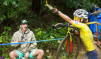 NWA Democrat-Gazette/BEN GOFF @NWABENGOFF<br /> Sarah Sturm of the United States grabs a dollar bill from the fishing pole of Taylor Young, a spectator from Bentonville, while competing in the UCI Elite Women race Sunday, Oct. 6, 2019, during the the Fayettecross cyclocross races at Centennial Park at Millsap Mountain in Fayetteville.