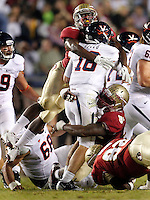 TALLAHASSEE, FL 11/19/11-FSU-UVA111911 CH-Florida State's Xavier Rhodes, left, and Everett Dawkins hit Virginia quarterback Michael Rocco during first half action Saturday at Doak Campbell Stadium in Tallahassee. .COLIN HACKLEY PHOTO
