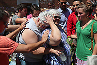 Surrounded by supporters, Kim and Susan Bro, middle, became emotional on Saturday as the visited the site where Heather Heyer died exactly one week ago after a car plowed through a group of people on 4th Street SE. This was the couple's first visit to the site. Photo/Andrew Shurtleff
