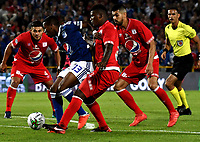 BOGOTÁ - COLOMBIA, 18-01-2019: Juan Camilo Salazar (Izq.) jugador de Millonarios disputan el balón con Marlon Torres (Cent.) y Julián Guevara (Der.) jugadores de América de Cali, durante partido entre Millonarios y América de Cali, por el Torneo Fox Sports 2019, jugado en el estadio Nemesio Camacho El Campin de la ciudad de Bogotá. / Juan Camilo Salazar (C) players of Millonarios struggle for the ball with Marlon Torres (C) and Julian Guevara (R) players of America de Cali, during a match between Millonarios and America de Cali, for the Fox Sports Tournament 2019, played at the Nemesio Camacho El Campin stadium in the city of Bogota. Photo: VizzorImage / Luis Ramírez / Staff.