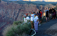 Aug. 22, 2014; GRAND CANYON, AZ, USA; Visitors take pictures on the south rim of the Grand Canyon at sunset in northern Arizona. The canyon has been formed over millions of years by the Colorado River cutting its way through the desert. Mandatory Credit: Mark J. Rebilas