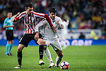 Alvaro Morata (rl) of Real Madrid battles for the ball with Aymeric Laporte of Athletic Club during their La Liga match between Real Madrid and Athletic Club at the Santiago Bernabeu Stadium on 23 October 2016 in Madrid, Spain. Photo by Diego Gonzalez Souto / Power Sport Images