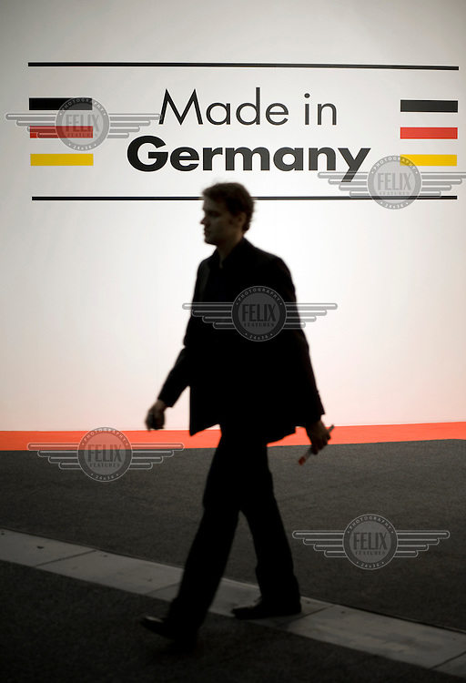 A visitor walks past a sign that reads Made in Germany at the International Funkausstellung (IFA), one of the world's largest consumer electronics trade exhibitions.
