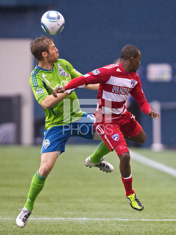 Seattle Sounders FC defender Jeff Parke heads the ball over FC Dallas forward Marvin Chavez during play at Qwest Field in Seattle Saturday May 14, 2011. Dallas won the game 1-0.
