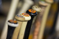 Norfolk Tides bats sit in the bat rack in the visitor's dugout during the International League game against the Charlotte Knights at BB&T BallPark on April 9, 2015 in Charlotte, North Carolina.  The Knights defeated the Tides 6-3.   (Brian Westerholt/Four Seam Images)