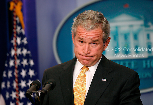 "Washington, DC - July 15, 2008 -- United States President George W. Bush holds a press conference in the Brady Press Briefing Room of the White House in Washington, D.C. on Tuesday, July 15, 2008.   During the 42 minute question and answer period, the President fielded questions concerning the bail-out of the Federal Home Loan Mortgage Corporation (FHLMC), commonly known as ""Freddie Mac"", and the Federal National Mortgage Association (FNMA), commonly known as ""Fannie Mae"";  the state of the American economy; the wars in Afghanistan and Iraq; high oil and gasoline prices; off-shore oil drilling; and the building of new refineries in the United States...Credit: Aude Guerrucci - Pool via CNP"