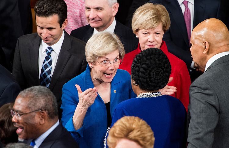 UNITED STATES - JANUARY 20: Sen. Elizabeth Warren, D-Mass., speaks with Rep. Sheila Jackson Lee, D-Texas, as Senators arrive for President Barack Obama's State of the Union address in the Capitol on Tuesday, Jan. 20, 2015. (Photo By Bill Clark/CQ Roll Call)