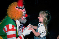 Shrine Circus clown having conversation with preschooler age 3.  St Paul Minnesota USA