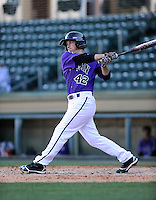 Designated hitter Jarrod Rickman (42) of the Furman Paladins hits in a game against the Miami (Ohio) Redhawks on Sunday, February 17, 2013, at Fluor Field at the West End in Greenville, South Carolina. Furman won, 6-5. (Tom Priddy/Four Seam Images)