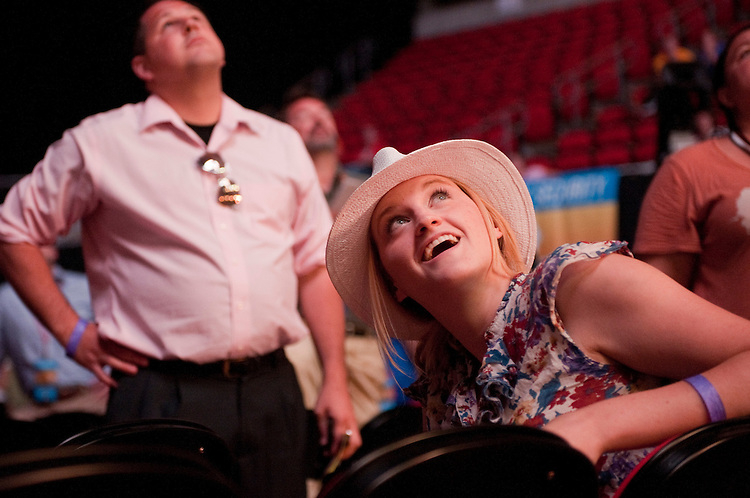 UNITED STATES - AUGUST 13:  Stacey Rogers of Ankeny, Iowa, sees on a scoreboard that her candidate, Michele Bachmann, won the Ames Straw Poll at Iowa State University in Ames, Iowa.  (Photo By Tom Williams/Roll Call)