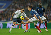Danny Williams of team USA and Laurent Koscielny of France fight for the ball during the friendly match France against USA at the Stade de France in Paris, France on November 11th, 2011.