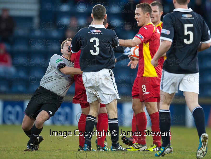 Referee Crawford Allan separates the players after Raith's Allan Walker two footed challenge ...