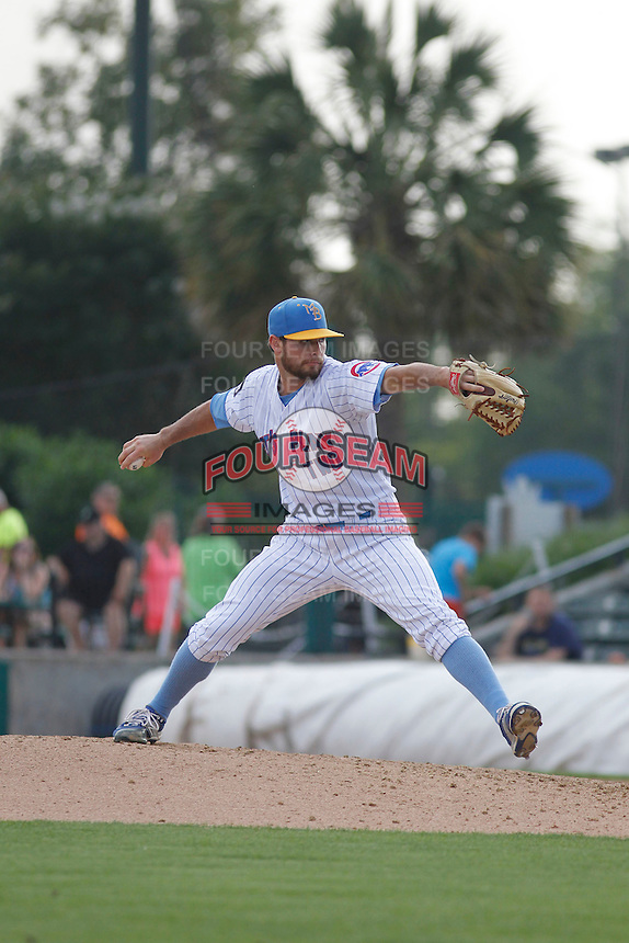 """Myrtle Beach Pelicans pitcher Josh Conway (11) on the mound during game one of a doubleheader against the Carolina Mudcats at Ticketreturn.com Field at Pelicans Ballpark on June 6, 2015 in Myrtle Beach, South Carolina. During the game the Pelicans wore special """"Let's Play Two"""" uniforms as a tribute to the late Chicago Cubs Hall of Famer Ernie Banks, as they do during the first game of every home doubleheader during 2015. Carolina defeated Myrtle Beach 1-0. (Robert Gurganus/Four Seam Images)"""