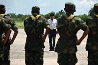 Bolivian Navy officers line up at the airport in front of President Evo Morales. Bolivia lost what is now northern Chile in a war over nitrates leaving Bolivia without access to the ocean.