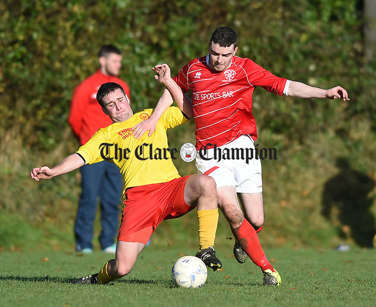 David Smyth of Avenue United A in action against David O Grady of Newmarket Celtic A during their FAI Junior Cup fourth round game at Mc Donough Park. Photograph by John Kelly.