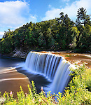 A very picturesque waterfall with silky motion blur, Tahquamenon Falls in Summer, Michigan's Upper Peninsula, USA