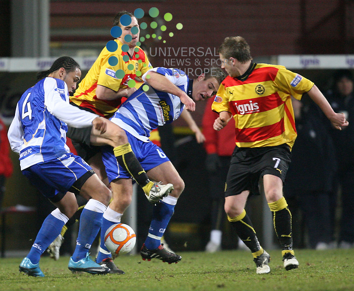 Jags Steve Lovell gets sandwiched between Morton's Dominic Shimmen(4) and Erik Paartalu(6) during the Irn-Bru Scottish Football First division match between Partick Thistle and Morton at Firhill Stadium 04/01/10. Picture By Ricky Rae/Universal News & Sport (Scotland)..