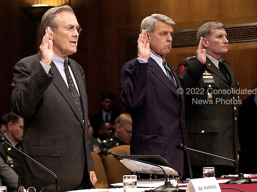 Deputy Commander United States Central Command Lieutenant General Lance Smith, Chairman Joint Chiefs of Staff General Richard B. Myers, Secretary of Defense Donald H. Rumsfeld, Acting Army Secretary Les Brwonlee and Army Chief of Staff General Pete Schoomaker swear in  prior to testifying  before the United States Senate Armed Services Committee on Capitol Hill May 7, 2004.  The Secretary and the rest of the Department of Defense heads will testify on the mistreatment of detainees in Iraq.  <br /> Mandatory Credit: Jerry Morrison / DoD via CNP