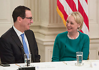 United States Secretary of the Treasury (left) speaks with Accenture North America CEO Julie Sweet during an American Technology Council roundtable with corporate and eduction leaders at The White House in Washington, DC, June 19, 2017. <br /> Credit: Chris Kleponis / CNP /MediaPunch