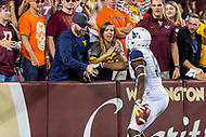 Landover, MD - SEPT 3, 2017: West Virginia Mountaineers wide receiver Gary Jennings (12) celebrates his touchdown with a fan during game between West Virginia and Virginia Tech at FedEx Field in Landover, MD. (Photo by Phil Peters/Media Images International)