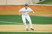 Jimmy Redovian (23) of the Wake Forest Demon Deacons takes his lead off of first base against the High Point Panthers at Wake Forest Baseball Park on April 2, 2014 in Winston-Salem, North Carolina.  The Demon Deacons defeated the Panthers 10-6.  (Brian Westerholt/Four Seam Images)