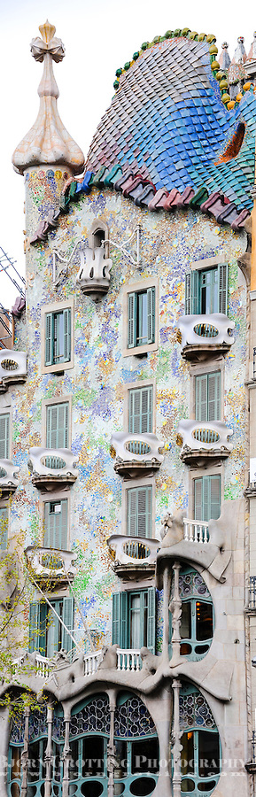 Spain, Barcelona. Casa Batlló is one of Antoni Gaudí's masterpieces. Panorama of exterior.