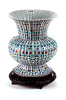 BNPS.co.uk (01202 558833)<br /> Pic: DiamondMills/BNPS<br /> <br /> £100 vase sells for £230,000...<br /> <br /> A rare Chinese vase that was uncovered during a house clearance has sold for a whopping £230,000 - 2300 times higher than its £100 estimate.<br /> <br /> The 10.75in piece had belonged to a unsuspecting Suffolk pensioner who was clearing his house to move into a care home.<br /> <br /> He had inherited the vase from an aunt who had lived in Singapore several years previously.<br /> <br /> Auctioneer Nigel Papworth knew he was on to a winner when an opening bid of £800 came in at the start of the auction and after fierce bidding from several Chinese buyers the hammer finally came down at a whopping £230,000.