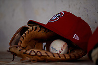 Chattanooga Lookouts hat, glove, and baseball sit in the dugout during a Southern League game against the Birmingham Barons on July 24, 2019 at Regions Field in Birmingham, Alabama.  Chattanooga defeated Birmingham 9-1.  (Mike Janes/Four Seam Images)