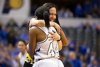 Penn head coach Kristi Kaniewski UIrich hugs guard Kamra Solomon (44) in the closing seconds of Penn's 68-48 win against Columbus North in the IHSAA Class 4A Girls Basketball State Championship Game on Saturday, Feb. 27, 2016, at Bankers Life Fieldhouse in Indianapolis.