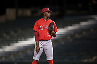 AZL Angels relief pitcher Darrien Williams (28) looks to his catcher for the sign during an Arizona League game against the AZL Diamondbacks at Tempe Diablo Stadium on June 27, 2018 in Tempe, Arizona. The AZL Angels defeated the AZL Diamondbacks 5-3. (Zachary Lucy/Four Seam Images)