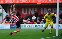 Crewe Alexandra's Ben Garratt saves from Lincoln City's Harry Anderson <br /> <br /> Photographer Chris Vaughan/CameraSport<br /> <br /> The EFL Sky Bet League Two - Lincoln City v Crewe Alexandra - Saturday 6th October 2018 - Sincil Bank - Lincoln<br /> <br /> World Copyright &copy; 2018 CameraSport. All rights reserved. 43 Linden Ave. Countesthorpe. Leicester. England. LE8 5PG - Tel: +44 (0) 116 277 4147 - admin@camerasport.com - www.camerasport.com