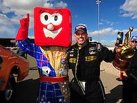 Apr. 1, 2012; Las Vegas, NV, USA: NHRA top alcohol funny car driver Tony Bartone celebrates after winning the Summitracing.com Nationals at The Strip in Las Vegas. Mandatory Credit: Mark J. Rebilas-