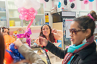 Owner Tabatha Lozano, center, waits on customers at the Sprinkle Splash Sweet Shoppe, the newest addition to the shops located in La Marqueta in East Harlem in New York, seen on its opening day, Saturday, April 2, 2016. Besides the incubator kitchen in the building there are a number of retail spaces in the revitalized facility rented by the entrepreneurs and small businesses which use the kitchen. (© Richard B. Levine)