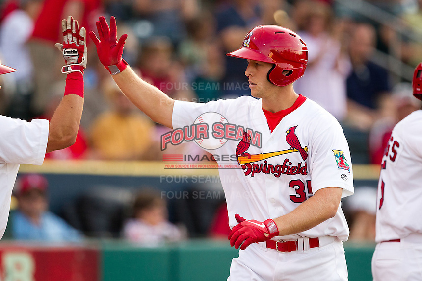 Kyle Conley (35) of the Springfield Cardinals celebrates with teammates after hitting a home run during a game against the Arkansas Travelers at Hammons Field on June 12, 2012 in Springfield, Missouri. (David Welker/Four Seam Images)