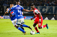BOGOTA, COLOMBIA - MARCH 03: Dairon Mosquera of Santa Fe fights for the ball with against Breiner Paz of Millonarios during the match between Millonarios and Independiente Santa Fe as part of the Liga BetPlay at Estadio El Campin on March 3, 2020 in Bogota, Colombia. (Photo by John W. Vizcaino/VIEW press/Getty Images)