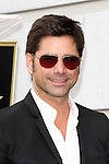 LOS ANGELES - FEB 6: John Stamos at a ceremony where rock band 'America' in honored with a star on the Hollywood Walk of Fame in Los Angeles, California