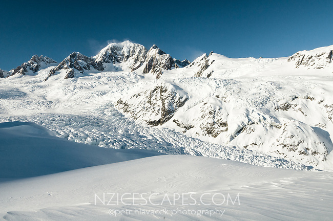 Stunning views of second highest peak in New Zealand Mt. Tasman 3497m, from Chancellor Shelf in winter. Fox Glacier in middle of frame, Westland Tai Poutini National Park, West Coast, UNESCO World Heritage Area, New Zealand, NZ